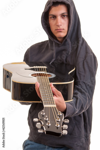 A young boy in hoodie show's you his guitar