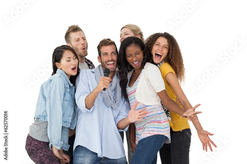 Group of happy people singing into microphone