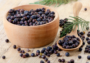 Wooden bowl with seeds of juniper