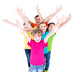 Group of smiling children with raised hands.