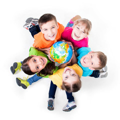 Group of kids sitting on the floor in a circle.