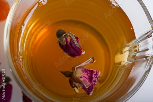 Dry roses in a  cup of tea