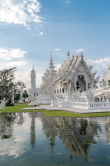 white temple  Wat Rong Khun and reflection.  Chiang Rai province