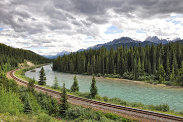 river, railway and Rocky Mountains in Banff National Park