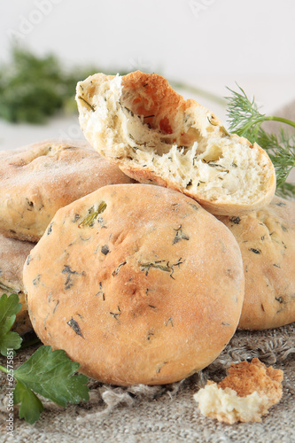 Slice of flat bread with greens