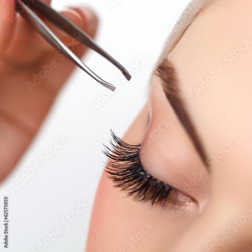 Tela Woman eye with long eyelashes. Eyelash extension. Eyebrow