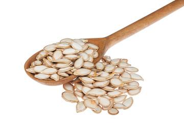 wooden spoon with pumpkin seeds