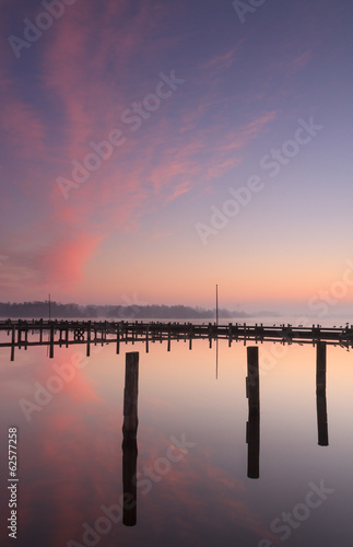 Tranquil and colorful sunrise at a small marina.