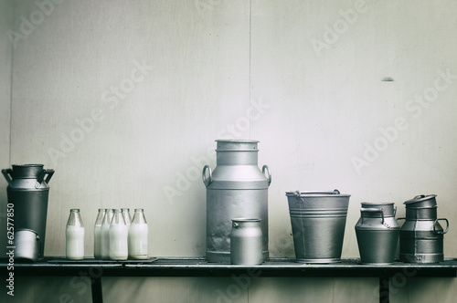 Old milk jugs, cans and bottles - 62577850