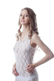 Shot of charming long-haired girl in lace negligee poster
