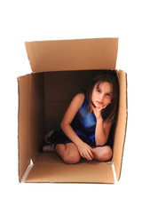 small girl in the paper box