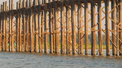 Pillars of the old wooden bridge. Burma, Mandalay, U Bein bridge