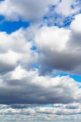 heavy woolpack clouds in spring sky