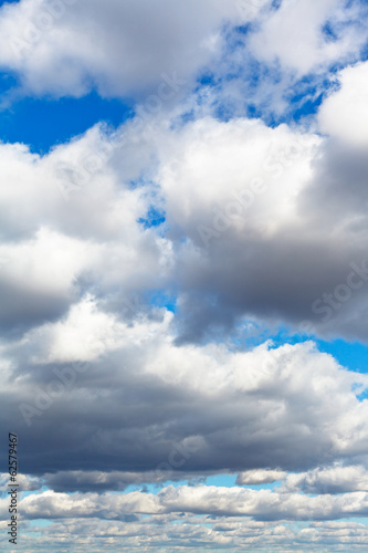 heavy woolpack clouds in spring sky