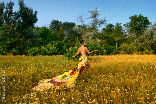 girl in the dress of the firebird of flowers