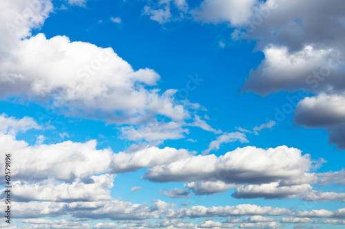 white woolpack clouds in blue sky