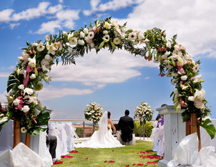 outdoor ceremony with boyfriends background with flowers and bow