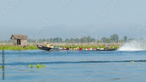 Boat with local people on Inle lake. Burma
