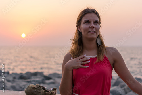 Beautiful young girl in the sunset