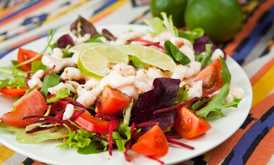 salad with prawns lime tomato lettuce arugula