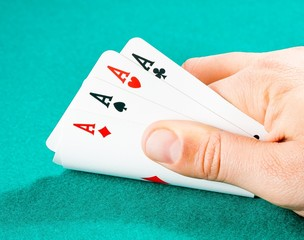 playing cards in a man hand
