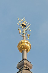 Detail on the top of the tower of the Jewish Town Hall at Prague