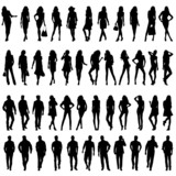Fototapety Silhouettes of happy young women  and men.