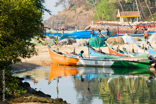 Image of fishermen coming back to Baga, Goa, India