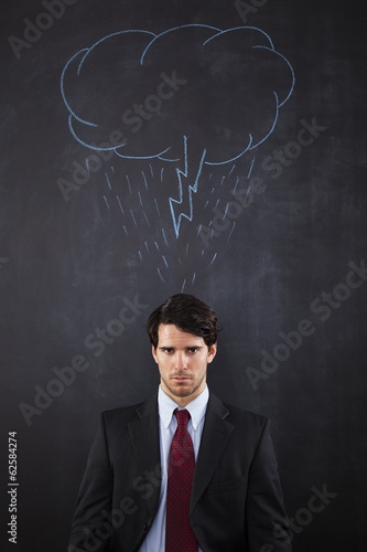 Businessman with a storm cloud abouve his head