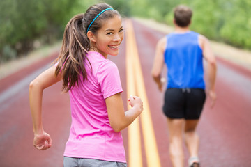 Woman runner smiling looking at camera