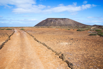Trail and volcano on Los Lobos island in the Canary Islands