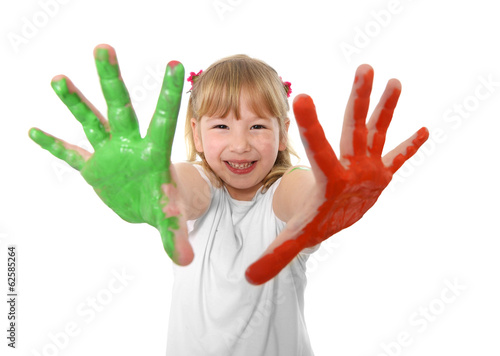 Sweet little girl showing painted hands in vibrant color