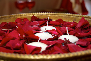 Bowl of petals and candles at the wedding
