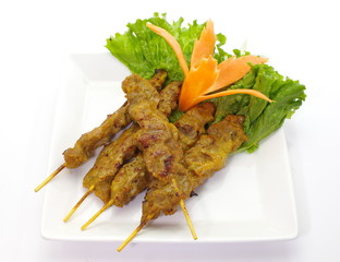Grilled Pork Satay with fresh vegetable on white background