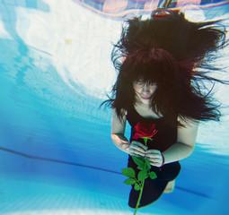Beautiful young Asian woman under water
