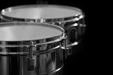Detail of drums on a black background