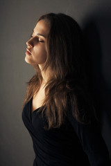 Beautiful young woman on a dark background