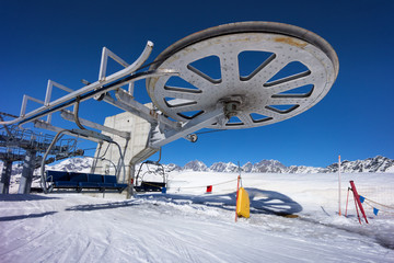 ski lift chair station on slope in mountain