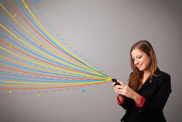 Happy girl holding a phone with colorful abstract lines