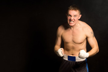 Angry determined young boxer