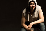 Shadowy portrait of a young man in a hoodie poster
