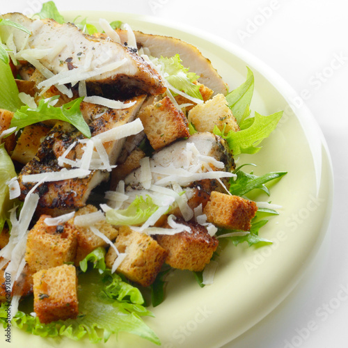 Caesar chicken salad on white background