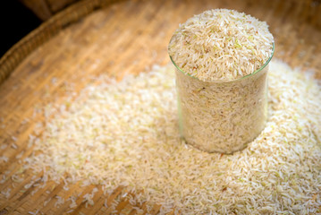 Rice in a test tube on threshing basket.