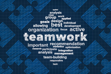 Teamwork concept in word cloud with abstract puzzle pieces