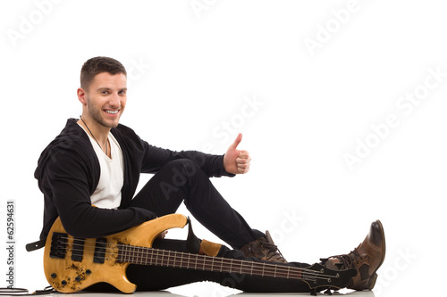 Smiling musician showing thumb up