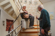 Leinwanddruck Bild - elderly couple at the stairlift