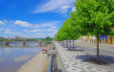 Street and view of Prague Castle and river in Czech Republic
