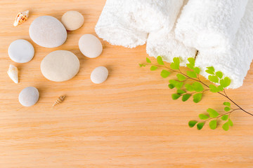 Spa concept with stones, shells, green branch  and white towels