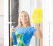 Woman washing window