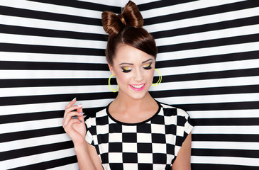 Attractive young woman  on stripy background
